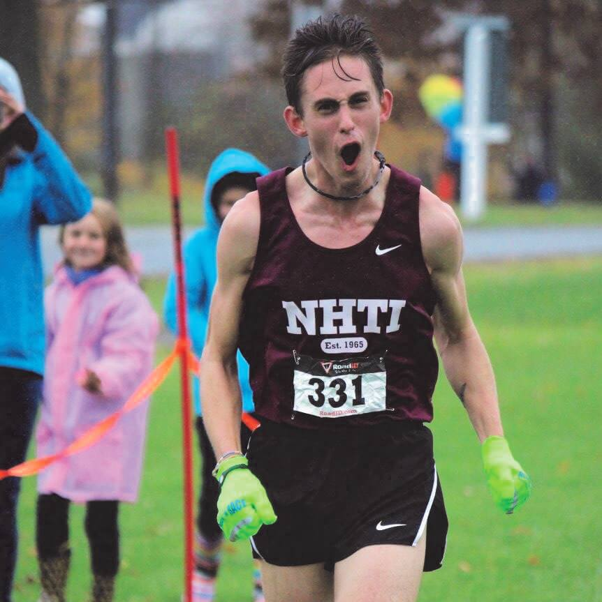 NHTI cross country runner celebrating